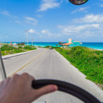 The-journey-at-the-wheel.-Electric-car-ride-to-the-island-of-Isla-Mujeres-Mexico-Cancun-834420326_5139x3426-scaled-1200x800