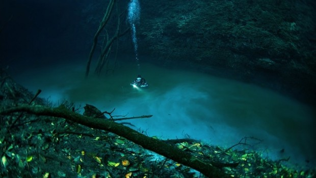 Discover an incredible underground river in the Cenote Angelita